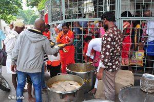 SRIVARI SEVAKS SERVING FOOD