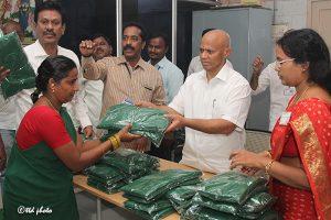 Distrubution of sarees to women barbers